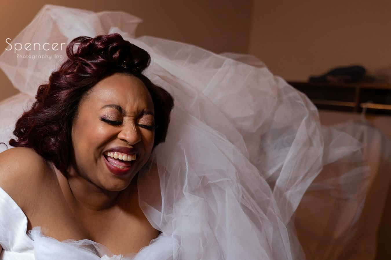 bride laughing at her wedding in Oberlin