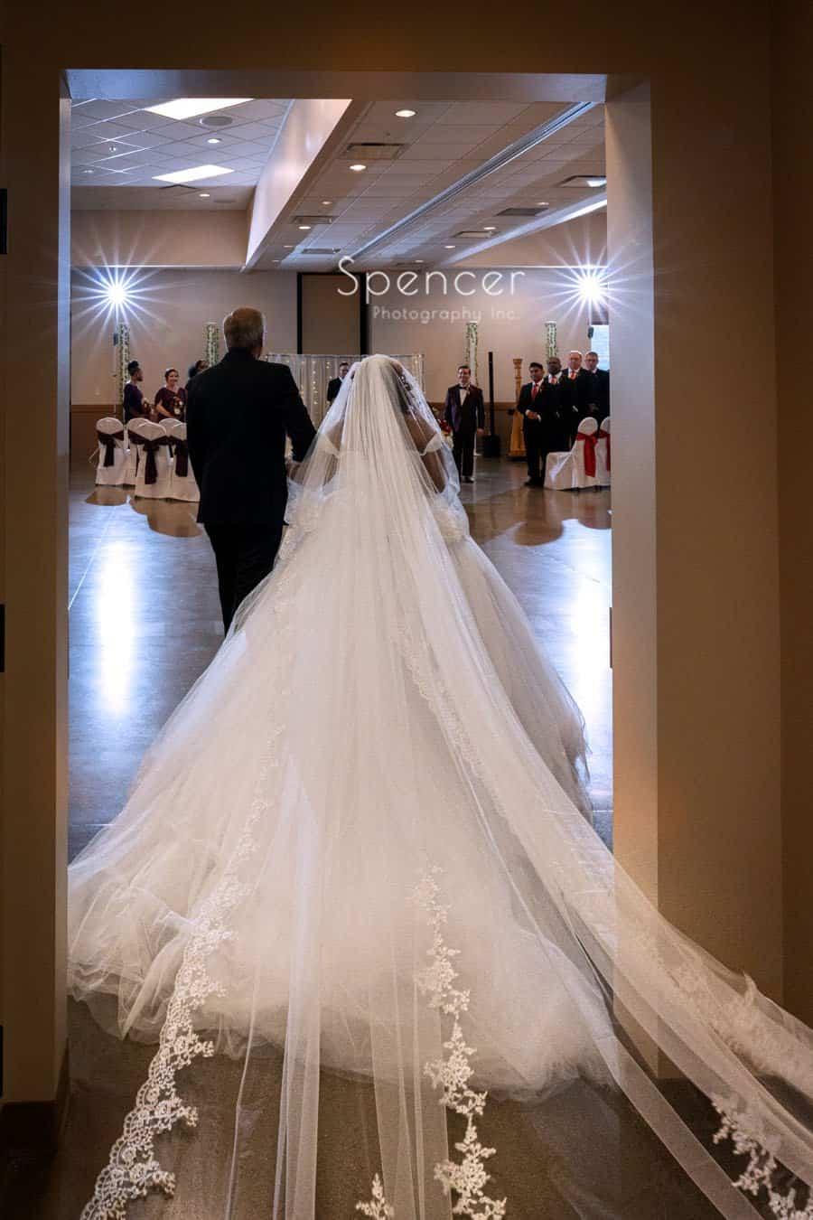 bride walking down wedding aisle in Oberlin