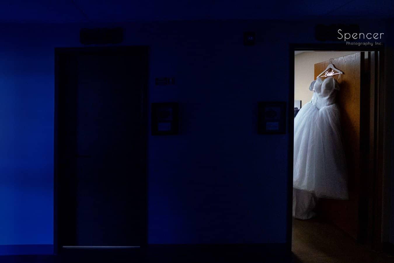 wedding dressin hanging in doorway at Oberlin Ohio wedding