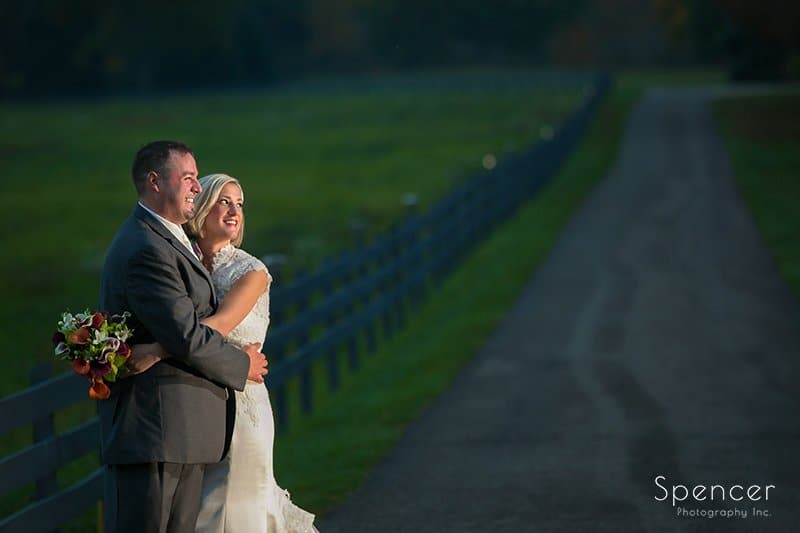 bride and groom on road to wedding reception at Brookside Farm