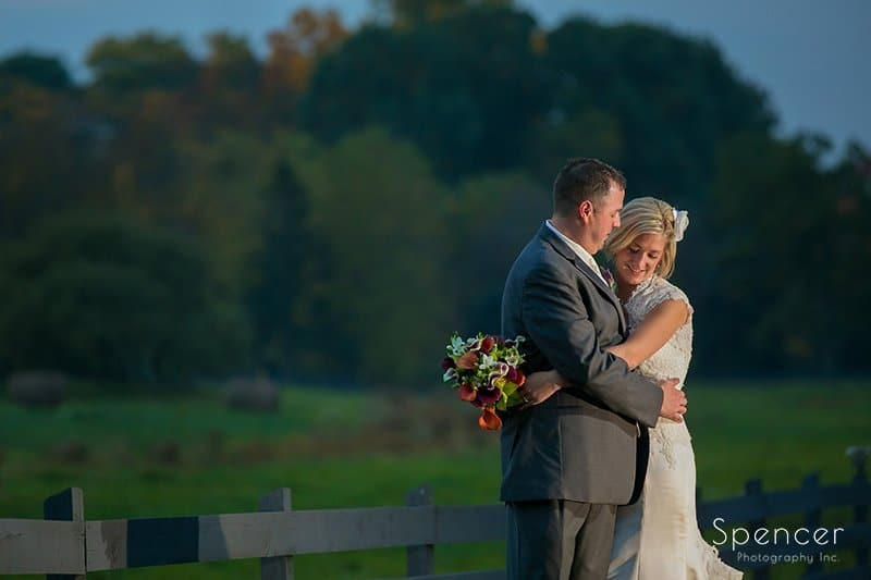 wedding picture of bride and groom laughing at their wedding reception at Brookside