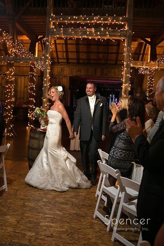 bride and groom entering their wedding reception at Brookside Farm