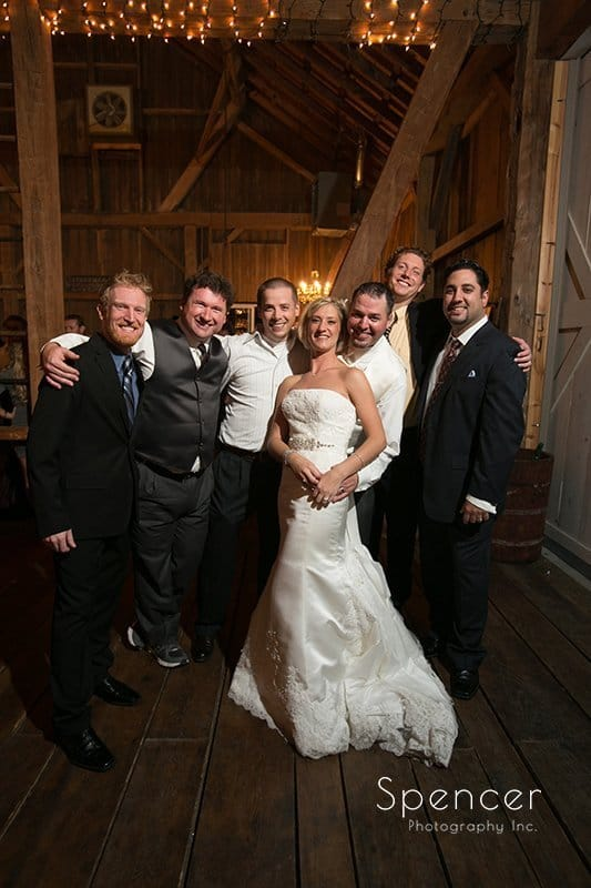 bride and groom in group photo at wedding reception at Brookside Farm