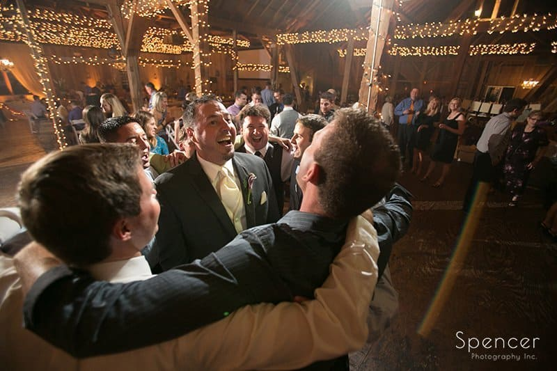 wedding guests dancing at reception at Brookside Farm