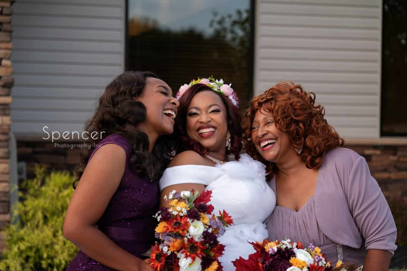 bride laughing with mom and sister