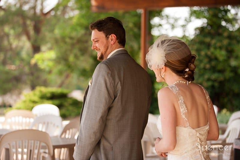 groom turns to look at bride