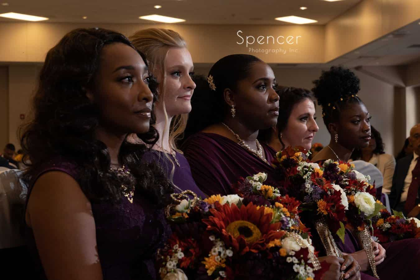 bridesmaids sitting at wedding ceremony in Oberlin