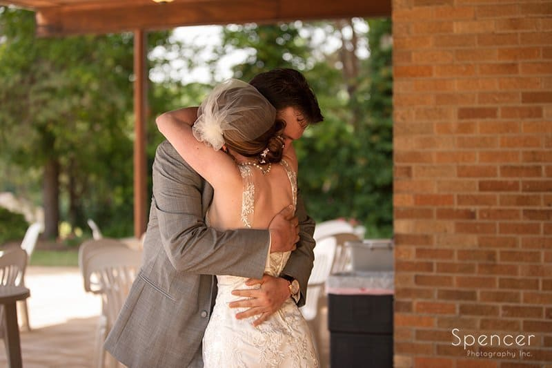bride and groom hugging on their wedding day