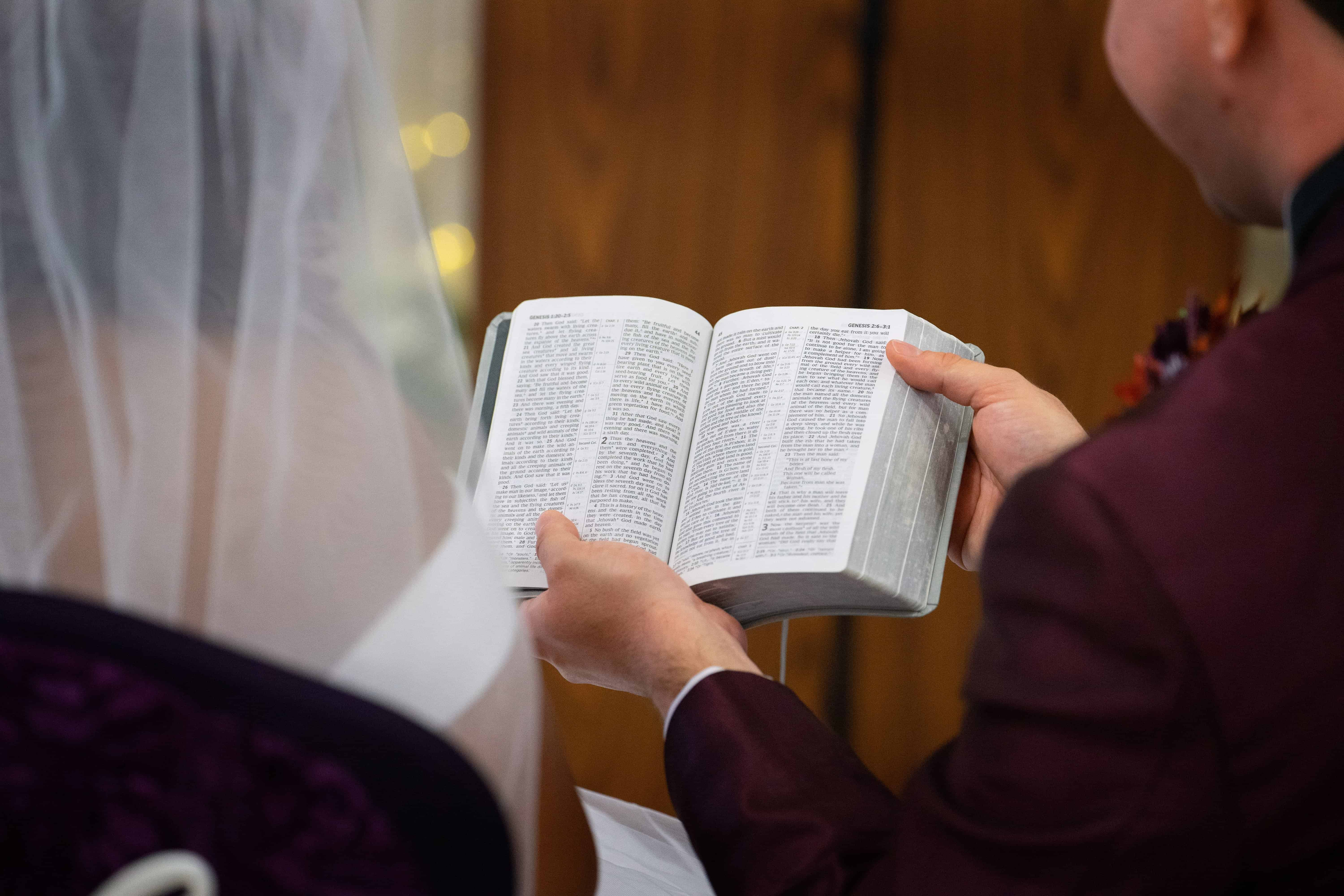 5 groom holding bible during wedding ceremony in Oberlin