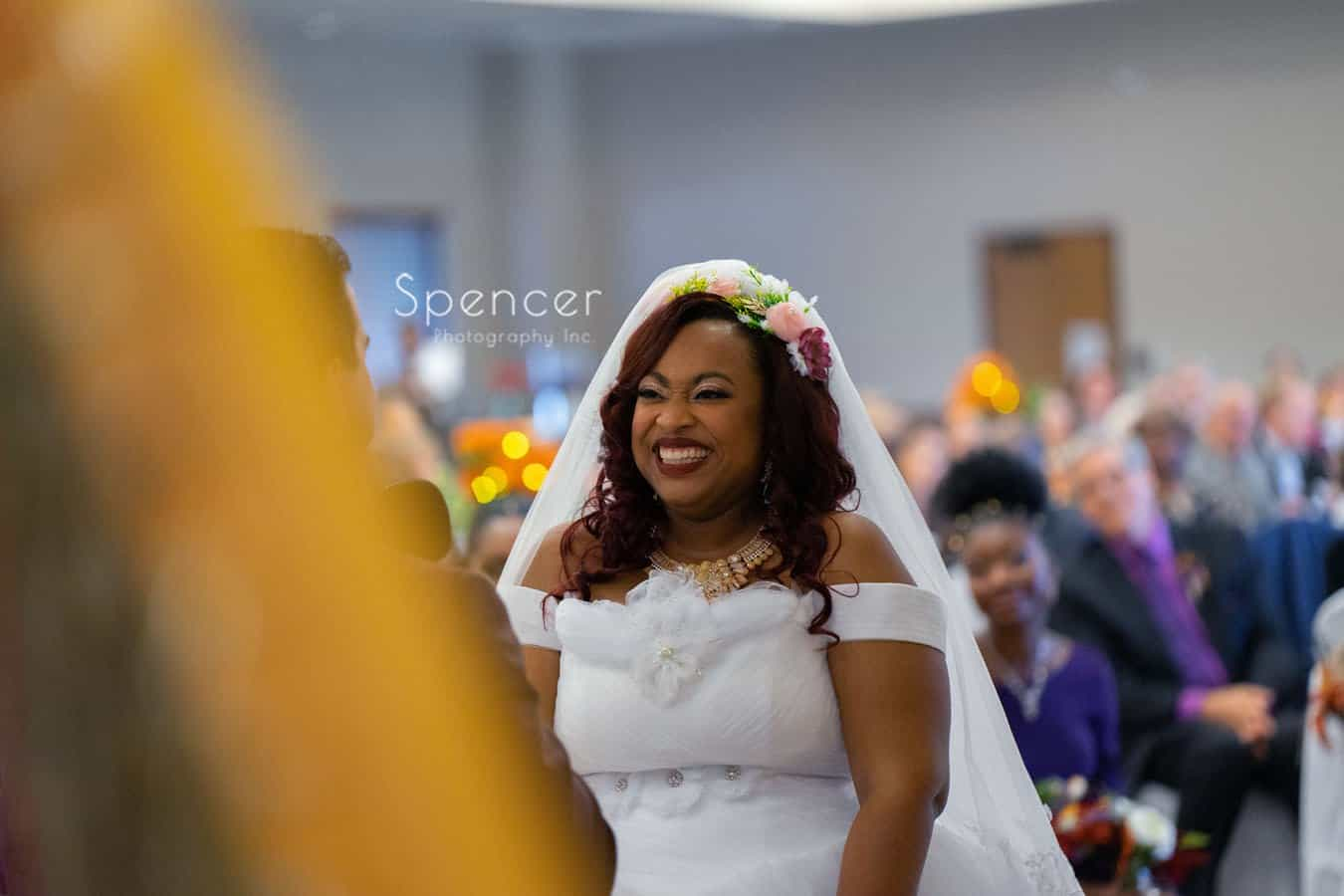 bride laughing at her wedding