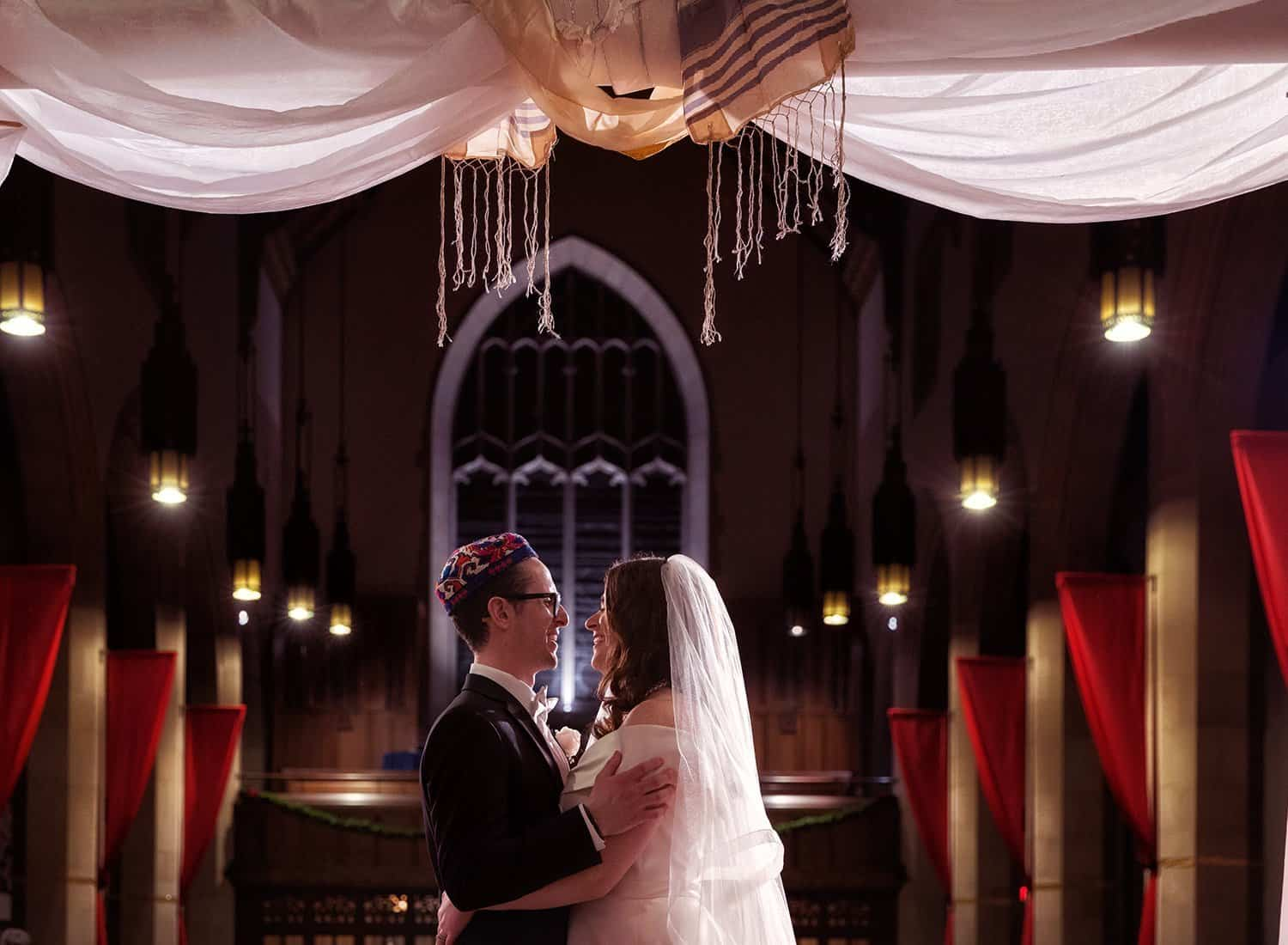 bride and groom facing each other in bapist chruch in Cleveland