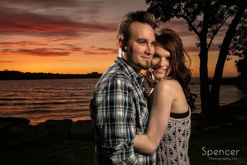 dramatic sunset picture of couple at engagement pictures at Edgewater Park