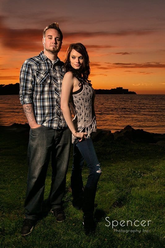 full length picture of couple during fall engagement pictures at Edgewater Park