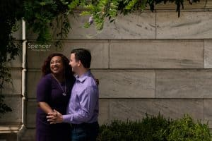 man smiling at woman during engagment pictures at Cleveland Museum of Art