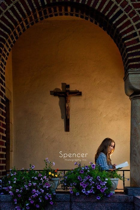 unique senior picture of girl at chruch reading bible