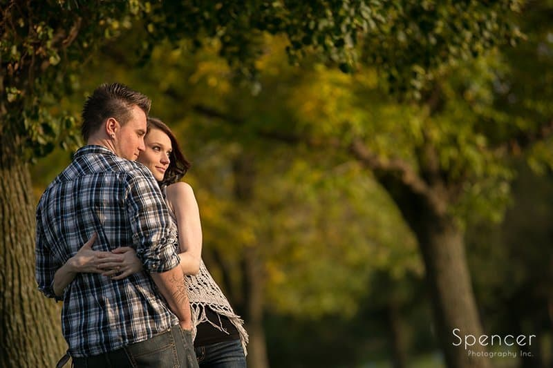 woman hugging man during engagement pictures at Edgewater Park Cleveland