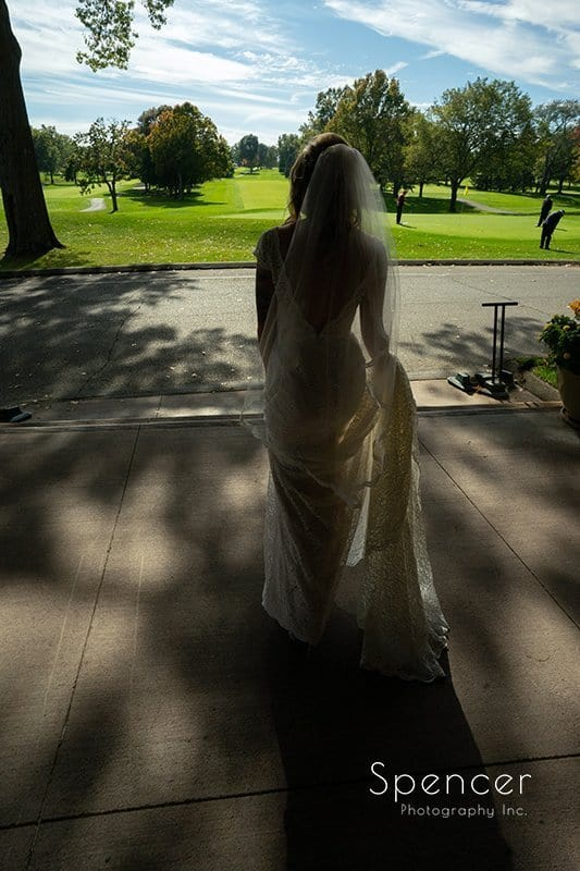 bride walking out of clubhouse at Firestone Country Club