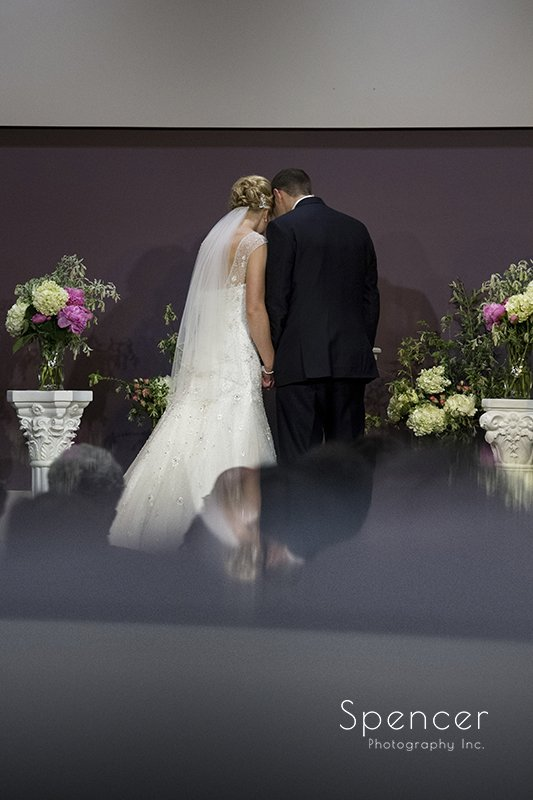 bride and groom in reflection at Canton Baptist Temple