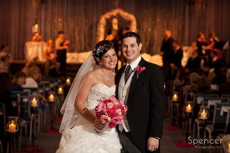 bride and groom recessional at Corner