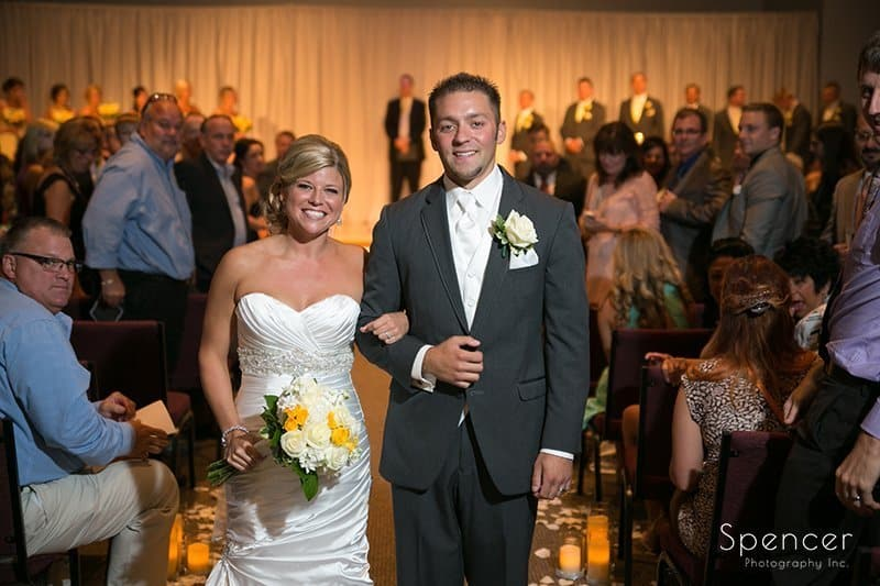 bride and groom walk down aisle after their wedding at Cuyahoga Valley Church