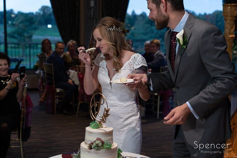bride laughing at Firestone Country Club before cutting cake