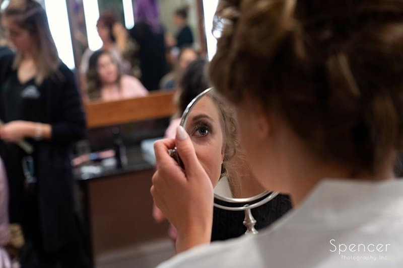 bride looking at her make up in a mirror at Firestone