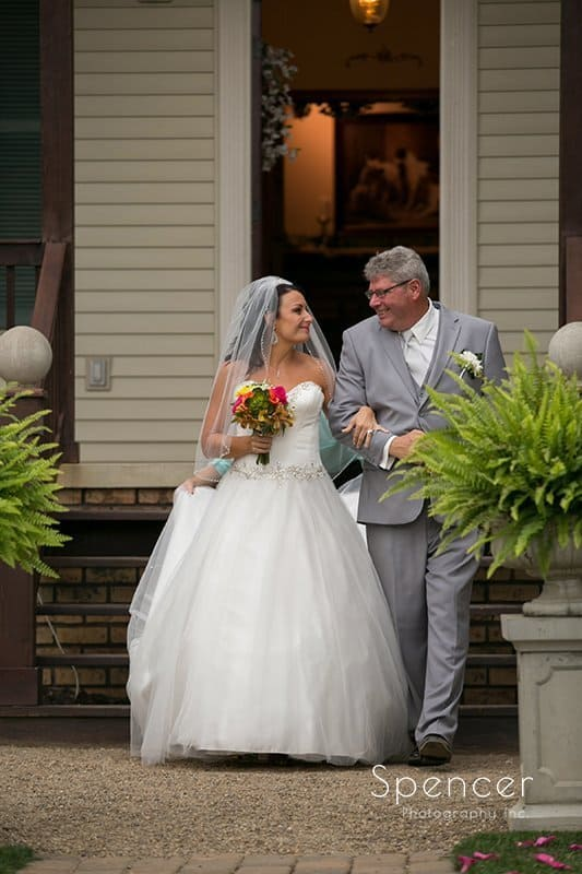 dad walking bride to her wedding at Country Cottage and Gardens