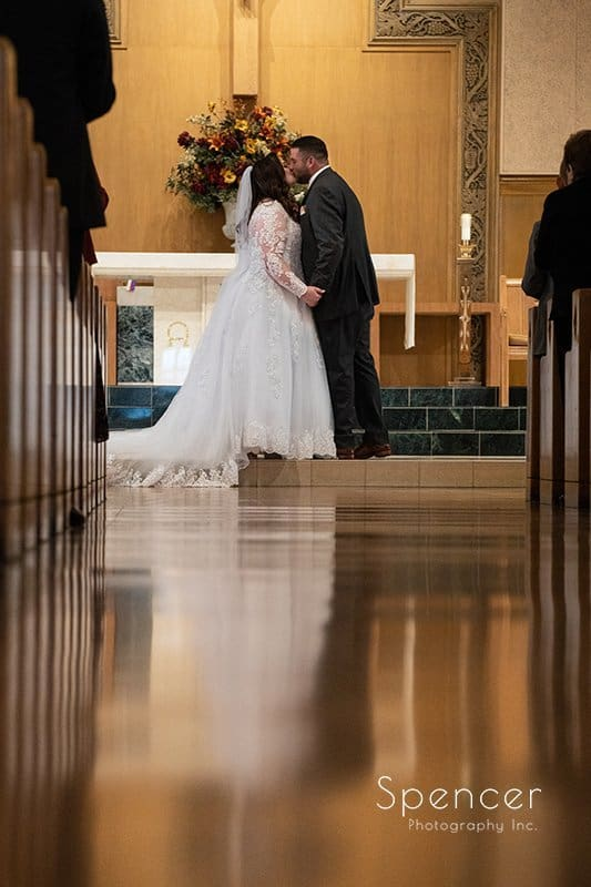 First kiss at wedding at Church of Saint Clare