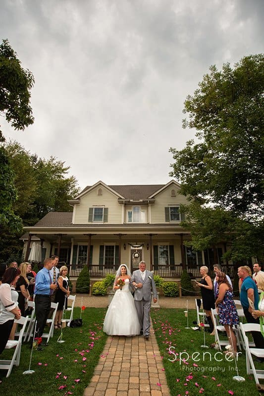 bride walking down aisle at Country Cottage and Gardens wedding