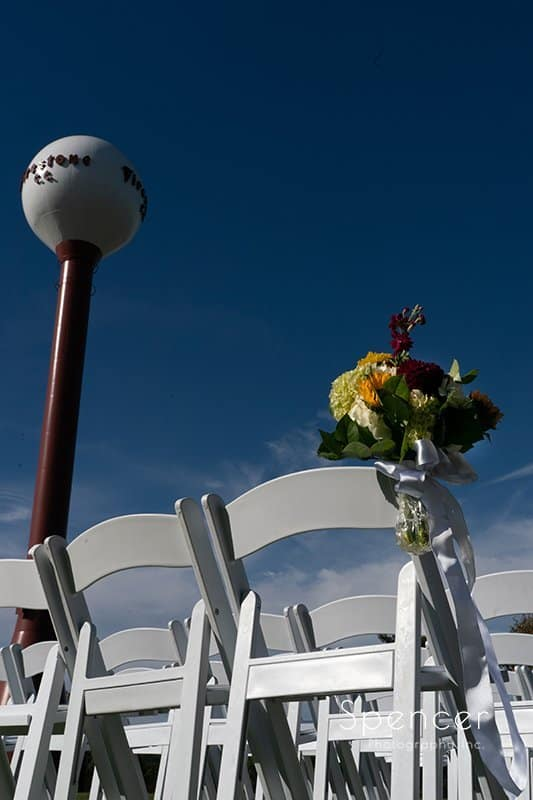 wedding ceremony flowers at Firestone Country Club