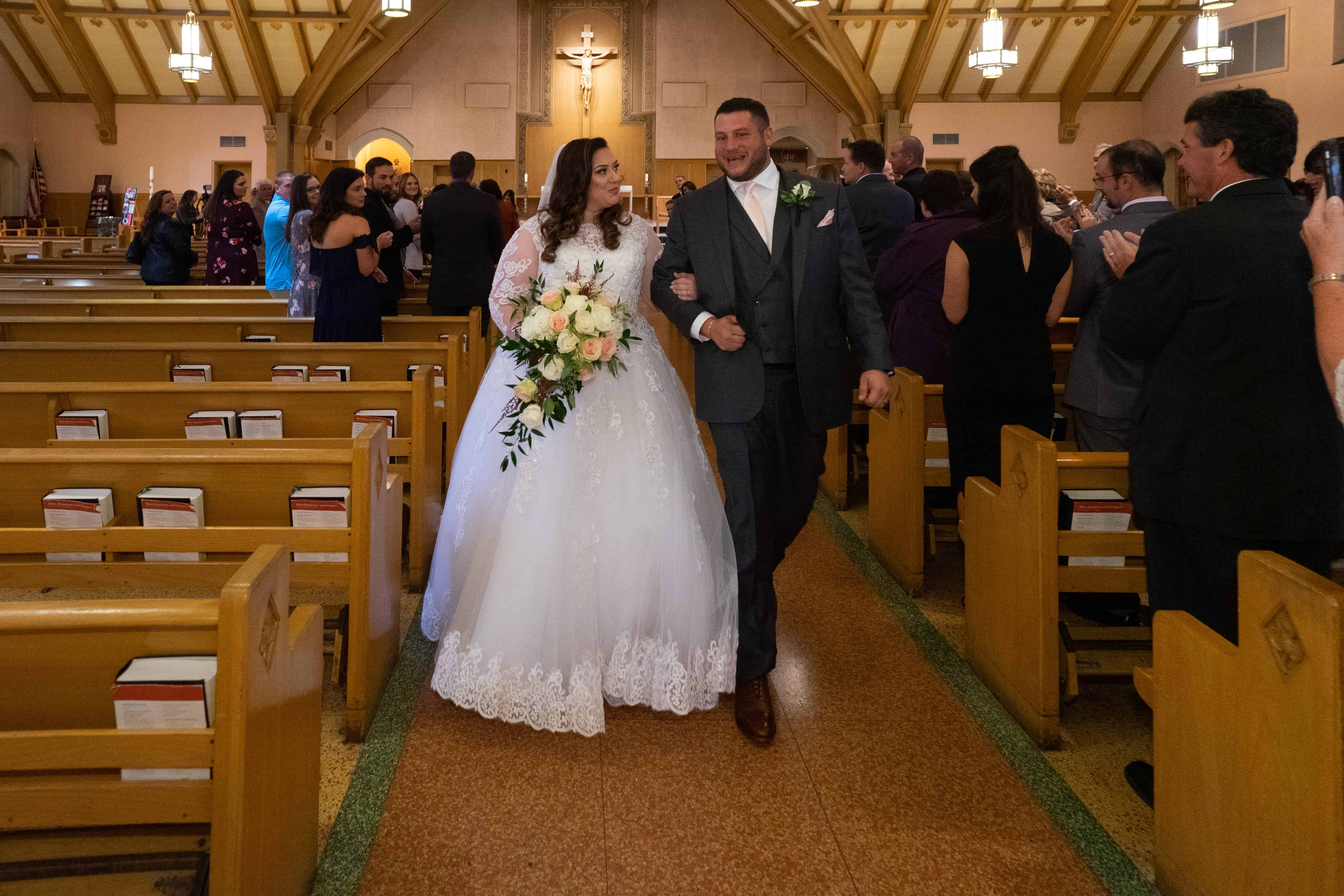 bride and groom walking after their wedding at Church of Saint Clare