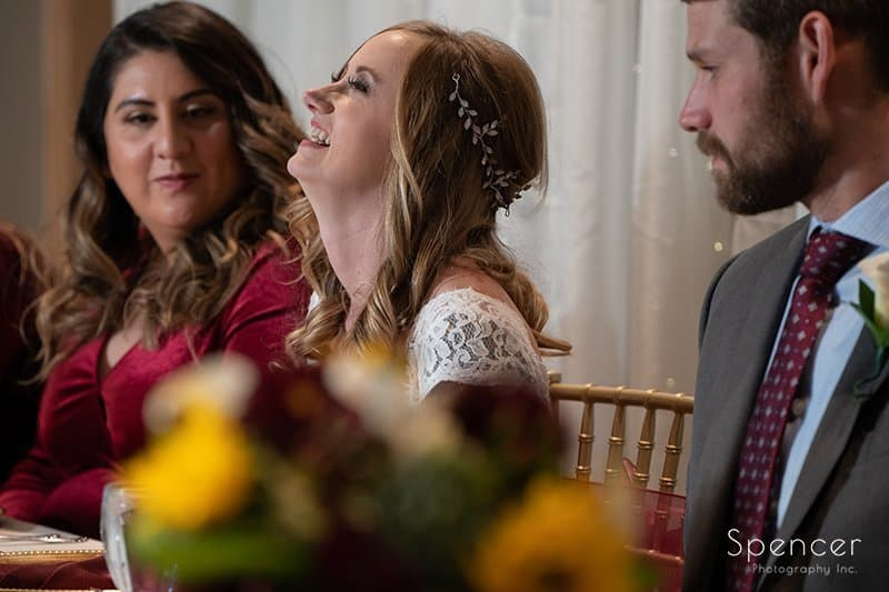 bride reacting to maid of honor speech at firestone