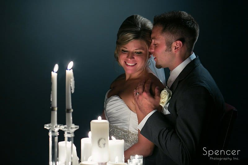 creative wedding picture of groom kissing bride at Cuyahoga Valley Church