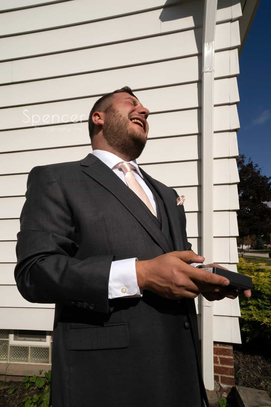 groom laughing on his wedding day in Mayfield Ohio