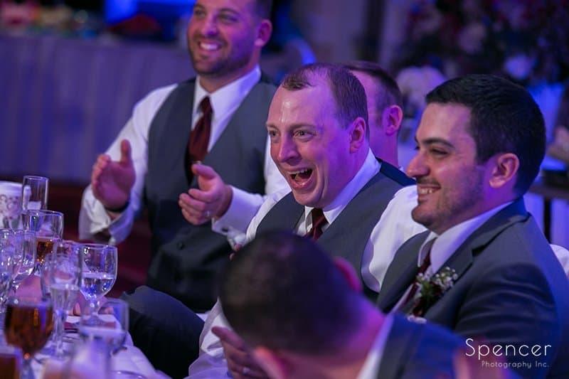 groomsmen laughing at wedding reception in Beachwood Ohio