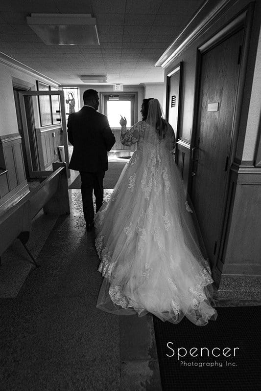 black and white picture of bride and groom leaving wedding at Church of Saint Clare