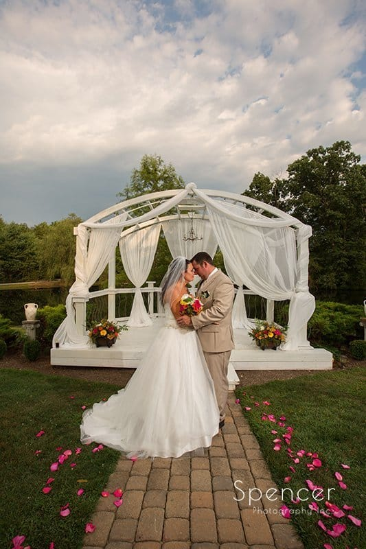bride and groom hugging in wedding picture at Country Cottage and Gardens