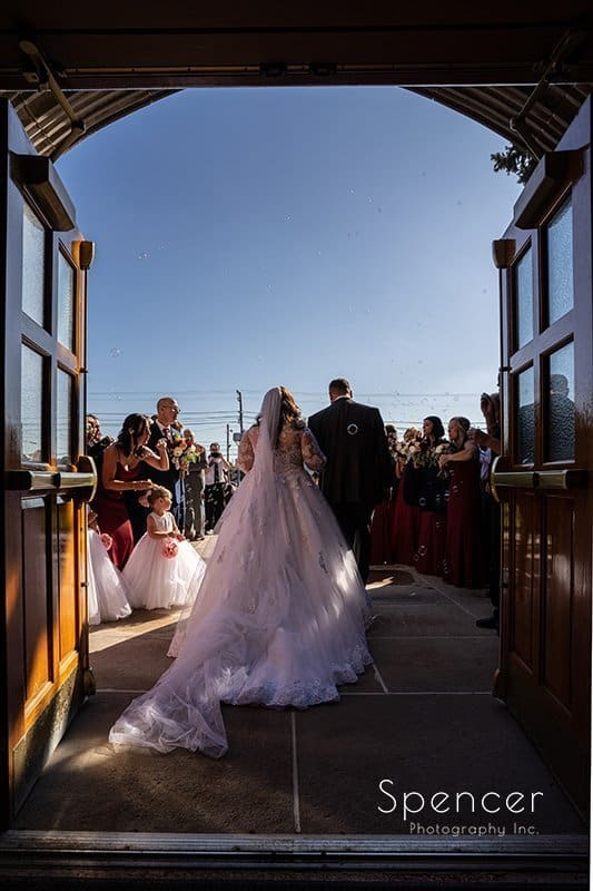 bride and groom walking out of Church of Saint Clare