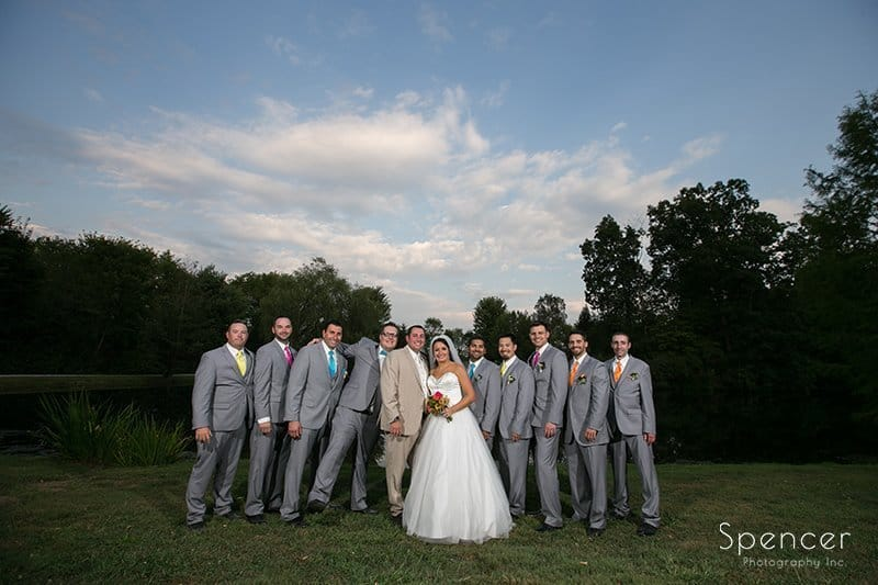 bride with groomsmen at Country Cottage and Gardens
