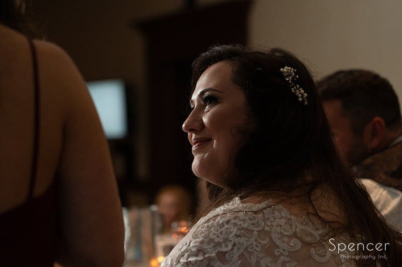 bride listening to maid of honor speech at LaMalfa