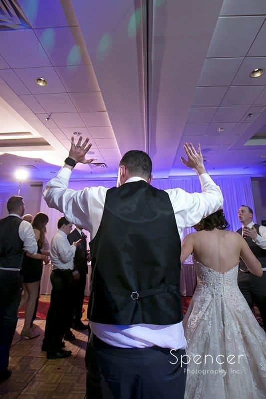 groom dancing at his wedding reception at Beachwood Ohio Embassy Suites