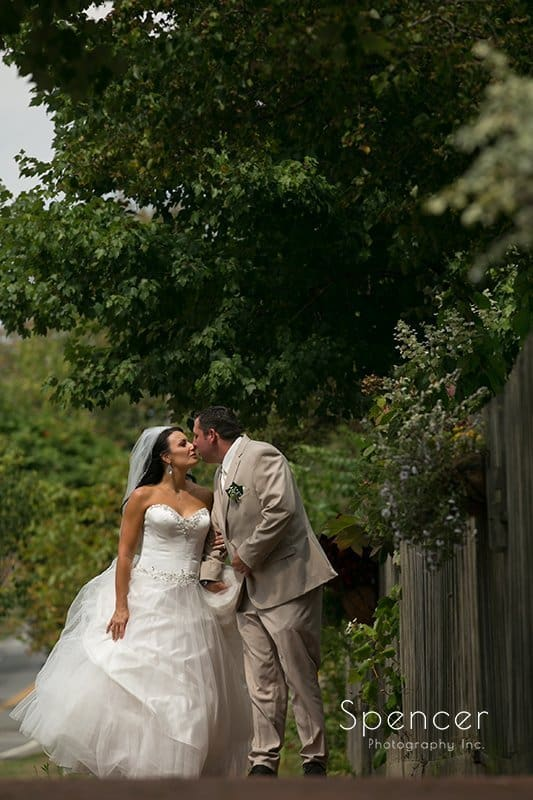 groom kissing bride after wedding at Country Cottage and Gardens
