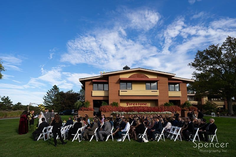 outside wedding ceremony at FIrestone Country Club