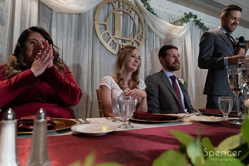 bridal party laughing at best man speech at firestone