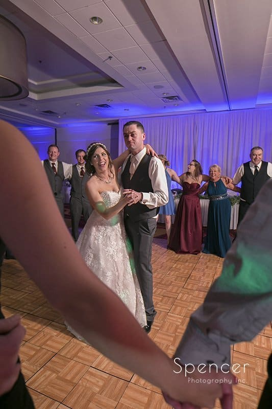 bride and groom dancing at their wedding reception at Embassy Suites Beachwood Ohio
