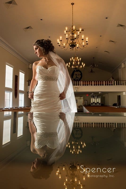 unique vertical wedding picture of bride at Church on the Lakes