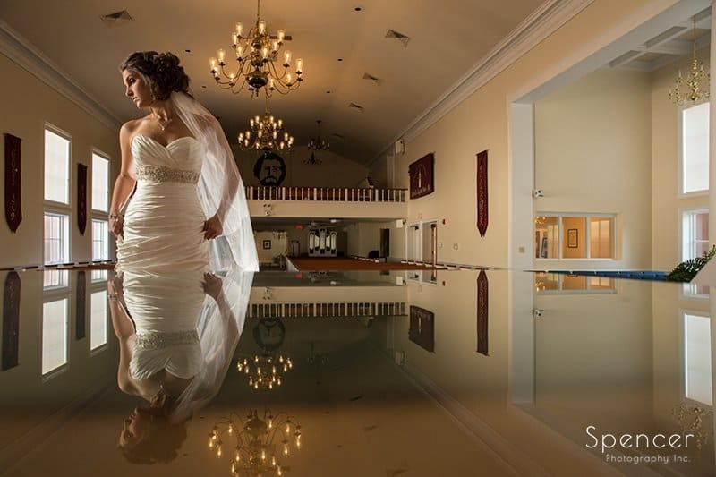 beautiful picture of bride with reflection at Chruch on the Lakes