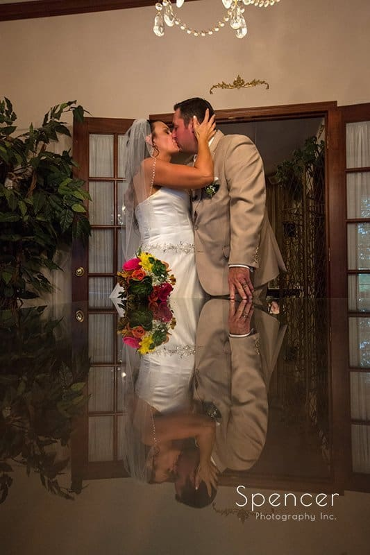 wedding picture of bride and groom kissing at Country Cottage and Gardens Canton