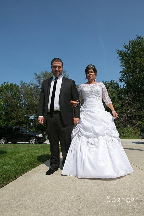 bride and groom walking during Muslim wedding