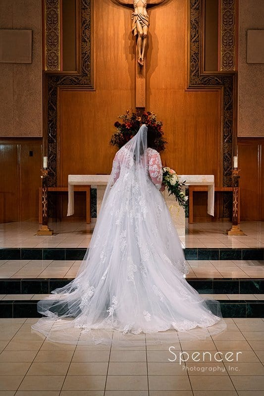 traditional wedding picture of bride on altar of Church of Saint Clare